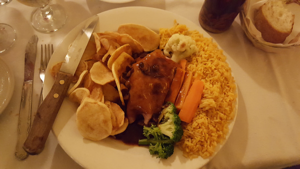 One of Greg's favorite meals: Filet Mignon a Portuguesa, served at Portuguese Manor in Perth Amboy. It is topped with ham and a garlic-wine sauce, and served with the traditional assortment of saffron rice, fried potatoes, and vegetables.